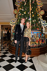POPPY DELEVINGNE and JAMES COOK at the Claridge's Christmas Tree By Dolce & Gabbana Launch Party held at Claridge's, Brook Street, London on 26th November 2013.