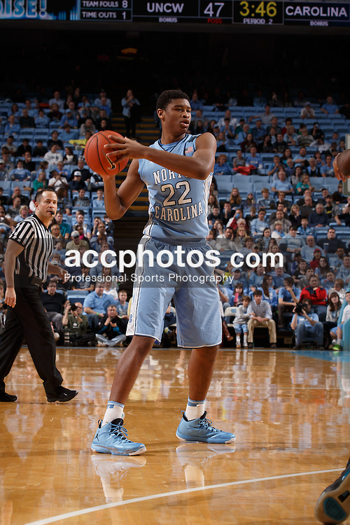 CHAPEL HILL, NC - DECEMBER 31: Isaiah Hicks #22 of the North Carolina Tar Heels plays the UNC Wilmington Seahawks on December 31, 2013 at the Dean E. Smith Center in Chapel Hill, North Carolina. North Carolina defeated UNC Wilmington 84-51. (Photo by Peyton Williams/UNC/Getty Images) *** Local Caption *** Isaiah Hicks