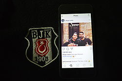 July 8, 2017 - Ankara, Turkey - In this photo illustration, the emblem of Besiktas football club and football player Diego Costa's latest post on Instagram are seen together in Ankara, Turkey on July 08, 2017. Besiktas' fans break the most commented post on Instagram as they write 'Come to Besiktas' to player's latest picture. The previous record was belonged to singer Selena Gomez with 1 million 168 thousand comments. (Credit Image: © Altan Gocher/NurPhoto via ZUMA Press)