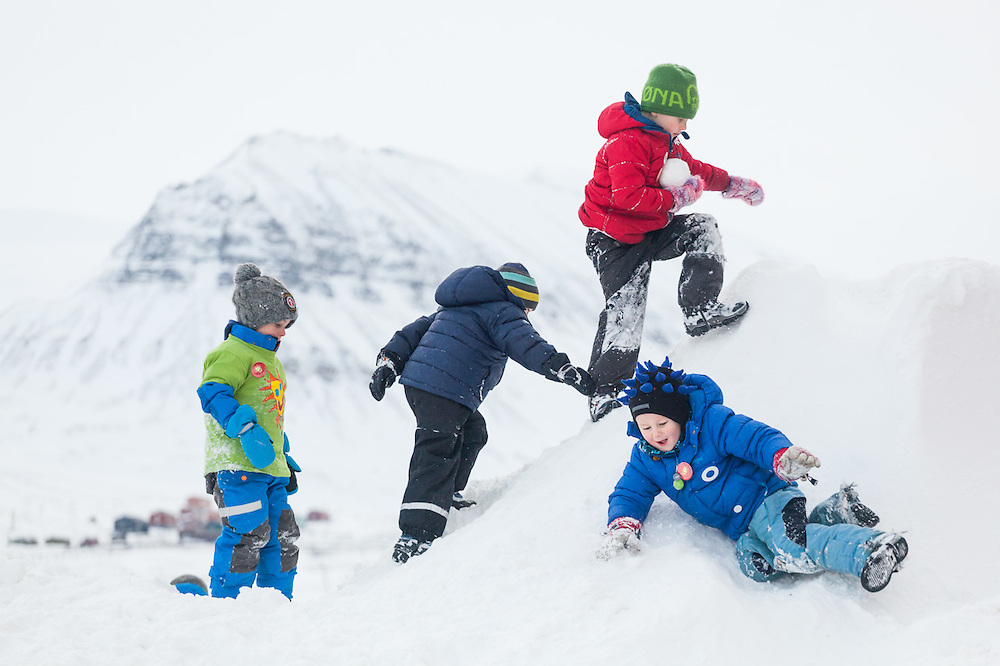 Children play in the snow at SolFest in Longyearbyen, Svalbard. The festival marks the official arrival of the sun to the town – by tradition, to the old hospital steps (sykehustrappa).