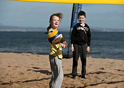 Today marks one year to go before the next Commonwealth Games get underway in Gold Coast, Australia. Athletes from a number of sports joined Scottish Beach Volleyball players, including top duo Lynne Beattie and Mel Coutts, on the new permanent courts on Portobello Beach this morning. The athletes joined with children from Towerbank Primary School to try out the game in the Portobello sunshine.   Pictured: Towerbank Primary School children<br /> <br /> <br /> © Jon Davey/ EEm