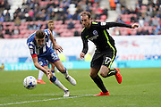 Brighton & Hove Albion centre forward Glenn Murray (17) gets away from Wigan Athletic defender Reece Burke (32) during the EFL Sky Bet Championship match between Wigan Athletic and Brighton and Hove Albion at the DW Stadium, Wigan, England on 22 October 2016.