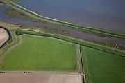 Nederland, Groningen, Oldambt, 08-09-2009; Johannes Kerkhovenpolder. Deze polder is een BV, het gelijknamige Akkerbouwbedrijf verbouwt tarwe, luzerne, suikerbieten en consumptieaardappelen. .Johannes Kerkhoven Polder. This polder is a private company, the farm grows wheat, luzerne, sugar beet and potatoes..luchtfoto (toeslag); aerial photo (additional fee required); .foto Siebe Swart / photo Siebe Swart