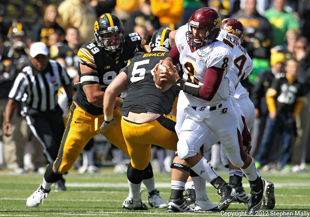 September 22 2012: Central Michigan Chippewas quarterback Ryan Radcliff (8) steps up in the pocket during the second half of the NCAA football game between the Central Michigan Chippewas and the Iowa Hawkeyes at Kinnick Stadium in Iowa City, Iowa on Saturday September 22, 2012. Central Michigan defeated Iowa 32-31.