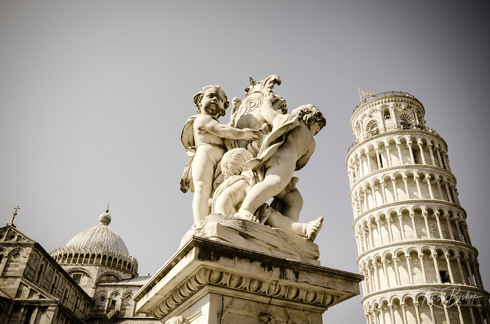 Cherub statue under the Leaning Tower and Pisa Cathedral, Pisa, Tuscany, Italy