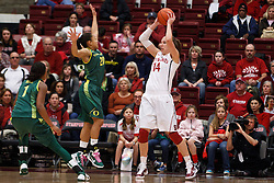 February 26, 2011; Stanford, CA, USA;  Stanford Cardinal forward Kayla Pedersen (14) is defended by Oregon Ducks guard Ariel Thomas (20) during the first half at Maples Pavilion.  Stanford defeated Oregon 99-60.