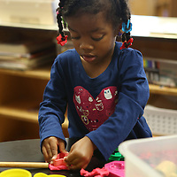 Lauren Wood | Buy at photos.djournal.com<br /> Peyton Jones, 3, plays with play-doh Thursday morning at the NMMC Child Care Center.