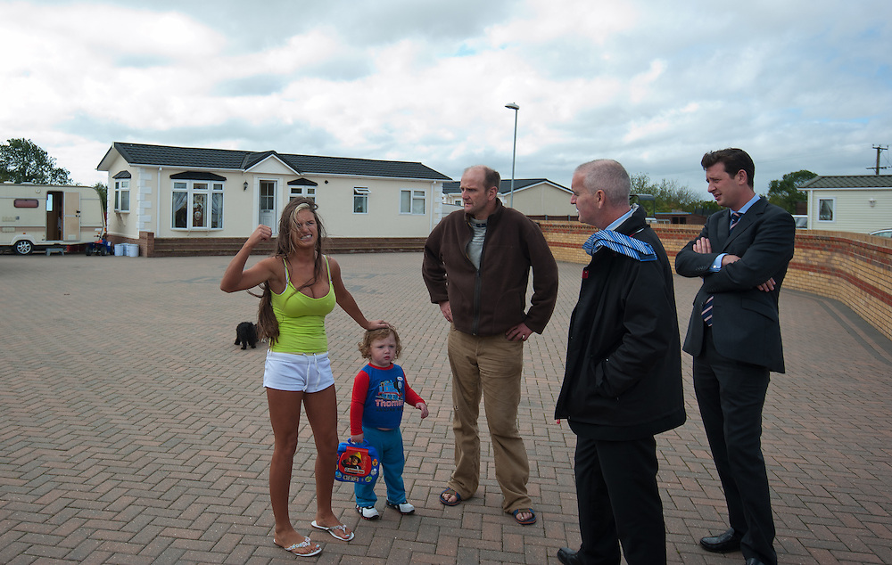 A women complains about her husband being arrested and Dave the man  on her left with her denies he's a slave as they speak to journalists  at Green  Acres caravan site near Leighton Buzzard.....Photos Ki Price