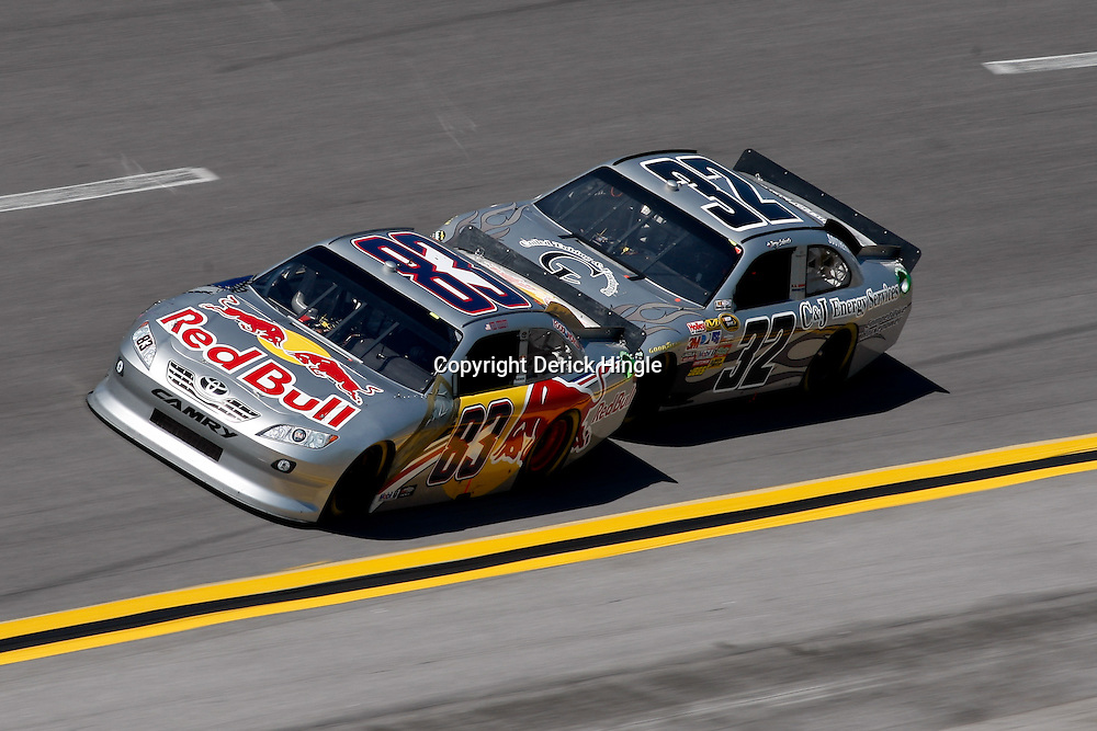 April 17, 2011; Talladega, AL, USA; NASCAR Sprint Cup Series driver Terry Labonte (32) drafts Brian Vickers (83) during the Aarons 499 at Talladega Superspeedway.   Mandatory Credit: Derick E. Hingle
