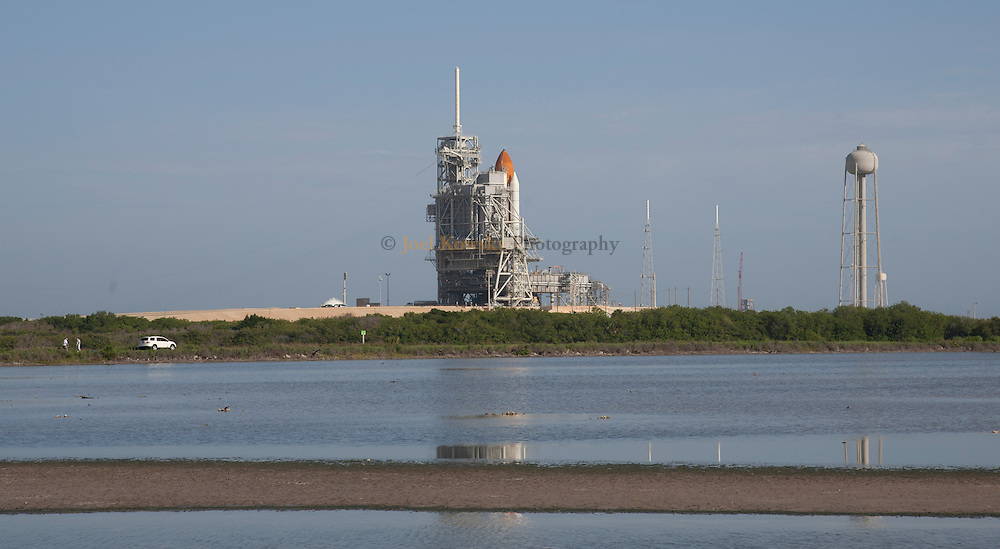 Cape Canaveral, Florida US - The space shuttle Atlantis sits on pad 39A as the RSS (Retractible Service Structure) is rolled back on the afternoon of Thursday, July 7, 2011.  Atlantis is set to blast off on the final mission of the Space Shuttle Program at 11:26AM on July 8, 2011.