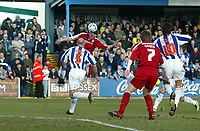Photo: Chris Ratcliffe.<br />Colchester United v Southend United. Coca Cola League 1. 04/03/2006.<br />Freddie Eastwood climbs above Colchester's Wayne Brown for Southend's opening goal.