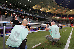Photographers surround Toulouse manager Alain Casanova. Toulouse v Trabzonspor, Europa Cup, Second Leg, Stade Municipal, Toulouse, France, 27th August 2009.