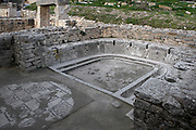 General view of the public lavatories in the Baths of the Cyclopes, 3rd century, in Dougga, Tunisia, pictured on January 31, 2008, in the afternoon.  Dougga has been occupied since the 2nd Millenium BC, well before the Phoenicians arrived in Tunisia. It was ruled by Carthage from the 4th century BC, then by Numidians, who called it Thugga and finally taken over by the Romans in the 2nd century. Situated in the north of Tunisia, the site became a UNESCO World Heritage Site in 1997. Picture by Manuel Cohen.