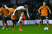 Hull City defender Callum Elder (26) fouls Leeds United forward Patrick Bamford (9) during the EFL Sky Bet Championship match between Leeds United and Hull City at Elland Road, Leeds, England on 10 December 2019.