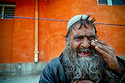 Arkansas Democrat-Gazette/BENJAMIN KRAIN 11-04-03<br /> A mentally ill man begs on the streets of Kabul. There are not enough resources to treat most mentally ill Afghani's who end up living on the streets.