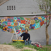 London,England,UK : 11th April 2016 : 'Endangered 13' Project, Louis Masai street artists painting 'Whale' raising awareness Endangered animal at Ackroyd Drive, Sponsor by Tower Hamlets council in London. Photo by See Li