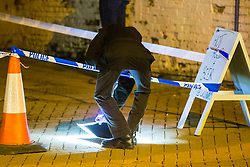 © Licensed to London News Pictures. 13/01/2018. Whittlesey UK. Picture shows police forensics officers on Market street in Whittlesey where there has been an alleged stabbing at the The 39th Straw Bear Festival in Whittlesey, it is unclear where the incident happened but police activity is concentrated around a Kebab shop on Market street. The Straw Bear festival is taking place this weekend. In times past when starvation bit deep the ploughmen of the area where drawn to towns like Whittlesey, They knocked on doors begging for food & disguised their shame by blackening their faces with soot. In Whittlesey it was the custom on the Tuesday following Plough Monday to dress one of the confraternity of the plough in straw and call him a Straw Bear. The bear was then taken around town to entertain the folk who on the previous day had subscribed to the rustics, a spread of beer, tobacco & beef. The bear was made to dance in front of houses & gifts of money, beer & food was expected.Photo credit: Andrew McCaren/LNP