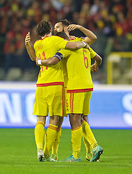 BRUSSELS, BELGIUM - Sunday, November 16, 2014: Wales' Gareth Bale celebrates with Joe Ledley and captain Ashley Williams after getting a point and staying top of the group after the final whistle of a goal-less draw against Belgium during the UEFA Euro 2016 Qualifying Group B game at the King Baudouin [Heysel] Stadium. (Pic by David Rawcliffe/Propaganda)