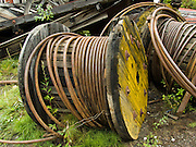 "Lengthy cables hung aerial trams which carried copper ore dug from Bonanza and Jumbo Mines on Bonanza Ridge. Kennecott Mines National Historic Landmark and nearby McCarthy are nestled under the glacier-clad Wrangell Mountains within Wrangell-St. Elias National Park and Preserve (the largest National Park in the USA), Alaska. Old mine buildings, artifacts, and colorful history attract summer visitors. Remote McCarthy is connected to Chitina via the McCarthy Road spur of the Edgerton Highway. At the east end of McCarthy Road, visitors must park their vehicle and walk across the footbridge to McCarthy. From McCarthy, a privately-operated shuttle takes visitors 5 miles to Kennecott. After copper was discovered between the Kennicott Glacier and McCarthy Creek in 1900, the Kennecott town, mines, and Kennecott Mining Company were created and named after the adjacent glacier. Kennicott Glacier and River had previously been named after Robert Kennicott, a naturalist who explored in Alaska in the mid-1800s. The corporation and town stuck with a mistaken spelling of ""Kennecott"" with an e (instead of ""Kennicott"" with an i). Partly because alcoholic beverages and prostitution were forbidden in the company town of Kennecott, the neighboring town of McCarthy grew quickly to provide a bar, brothel, gymnasium, hospital, and school. The Copper River and Northwestern Railway reached McCarthy in 1911 to haul over 200 million dollars worth of ore 196 miles to the port of Cordova on Prince William Sound. By 1938, the world's richest concentration of copper ore was mostly gone, the town was mostly abandoned, and railroad service ended. Not until the 1970s did the area began to draw young people for adventure and the big money of the Trans Alaska Pipeline project. Declaration of Wrangell-St. Elias National Park in 1980 drew adventurous tourists who helped revive McCarthy with demand for needed services. Wrangell-St. Elias is honored by UNESCO as part of a World Heritage Site."