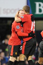 Wayne Rooney (Manchester United) celebrates his third goal with team mate Nemanja Vidic (Manchester United)  . Portsmouth v Manchester United (1-4), Barclays Premier League Fratton Park, Portsmouth, 28th November 2009.