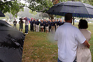 As a steady rain falls, a group of U.S. Marine Corps recruits are sworn in before the 2012 Holiday at Home Parade on Far Hills Avenue in Kettering, Monday, September 3, 2012.