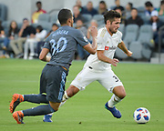 Los Angeles FC midfielder Benny Feilhaber (33) moves the ball against New York City midfielder Yangel Herrera (30) during a MLS soccer match in Los Angeles, Sunday, May 13, 2018. The game ended in a 2-2 tie. (Ed Ruvalcaba/Image of Sport)