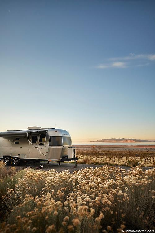 An airstream trailer camped at Antelope Island State Park near Salt Lake City, Utah.