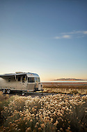 An airstream trailer camped at Antelope Island State Park near Salt Lake City, Utah.