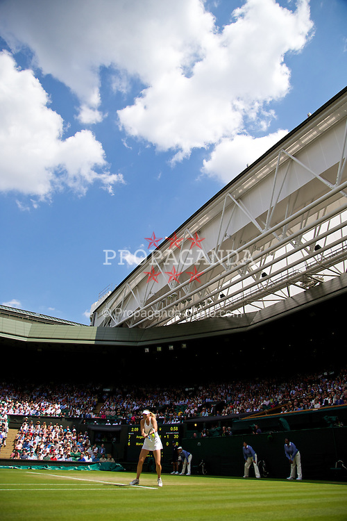 LONDON, ENGLAND - Tuesday, July 1, 2014: Maria Sharapova (RUS) in action on centre court during the Ladies' Singles 4th Round match on day eight of the Wimbledon Lawn Tennis Championships at the All England Lawn Tennis and Croquet Club. (Pic by David Rawcliffe/Propaganda)