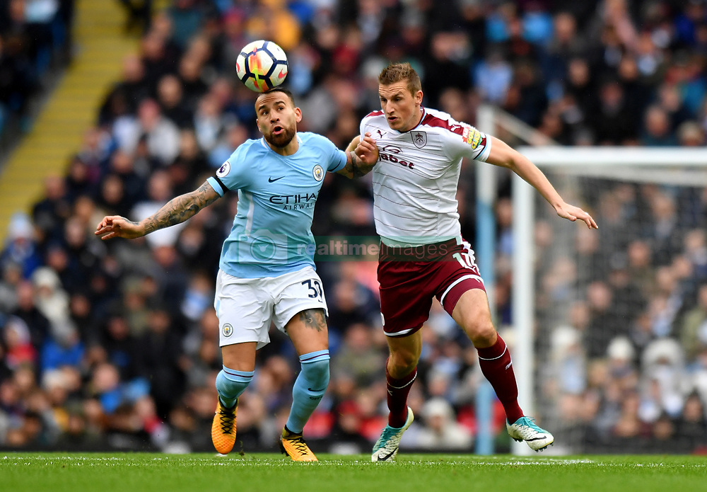 Manchester City's Nicolas Otamendi (left) and Burnley's Chris Wood battle for the ball