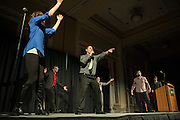 """Marc Barr, lecturer of Excercise Physiology in the School of Applied Health Sciences and Wellness, lip-sings to Lady Gaga's """"Poker Face"""" during the 2015 Ava Nichols Faculty Pageant in Baker University Ballroom on Wednesday, February 25."""