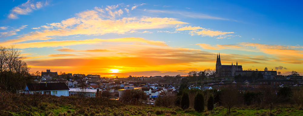 Another Armagh sunset from yesterday. The clouds near the horizon meant it was an early light show for this sunset, offering some wonderful golden colours.<br /> <br /> Image composed of 6 photos at 35mm in portrait orientation.