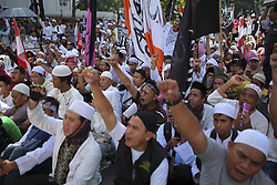 April 28, 2017 - Jakarta, Jakarta, Indonesia - Indonesian Muslims shout slogans during a demonstration outside of North Jakarta court, to demand the court comply with the constitution and fire this blasphemous defendant Jakarta Governor, Basuki ''Ahok'' Tjahaja Purnama, in Jakarta, Indonesia on April 28, 2017. Basuki Tjahaja Purnama has been accused of insulting he Quran during a speech in the Thousand Islands at the end of September that later triggered uproar across Indonesia -- the world's most populous Muslim nation. Prosecutors demanded a two-year probation period with a possible one-year jail term for Jakarta Governor, Basuki ''Ahok'' Tjahaja Purnama. (Credit Image: © Agoes Rudianto/NurPhoto via ZUMA Press)
