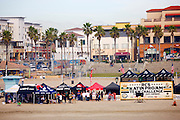 Surfers competing in the Katin Pro/Am surf competition at Huntington Beach Pier, Orange County, California.