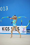 Chun Song E during ribbon routine at the World Cup of Pesaro, Italy , 26 April, 2013.  Chun is a Korean individualistic gymnast, born on 1997 in Seul.