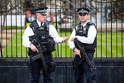 © Licensed to London News Pictures. 28/03/2017. London, UK. Armed police stand at the entrance to Parliament. Security around London has been increased following Khalid Masood's terrorist attack and the killing of PC Keith Palmer on 22 March. Photo credit : Tom Nicholson/LNP