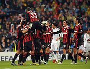 Andrea Pirlo is mounted as the AC Milan players celebrate his goal against Real Madrid.
