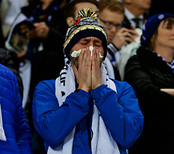 LEICESTER, ENGLAND - Saturday, November 10, 2018: A Leicester City supporter is overcome with emotion as the club pays tribute to chairman Vichai Srivaddhanaprabha, who died in a helicopter crash on Oct 27, during the FA Premier League match between Leicester City FC and Burnley FC at the King Power Stadium. (Pic by David Rawcliffe/Propaganda)