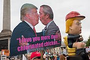 On US President Donald Trump's second day of a controversial three-day state visit to the UK, the images of Trump and Brexit figure Nigel Farage among protesters voicing their opposition to the 45th American President, in Trafalgar Square, on 4th June 2019, in London England.