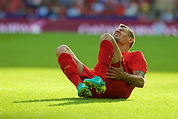 LONDON, ENGLAND - Saturday, August 6, 2016: Liverpool's Dejan Lovren lies injured during the International Champions Cup match against FC Barcelona at Wembley Stadium. (Pic by Xiaoxuan Lin/Propaganda)