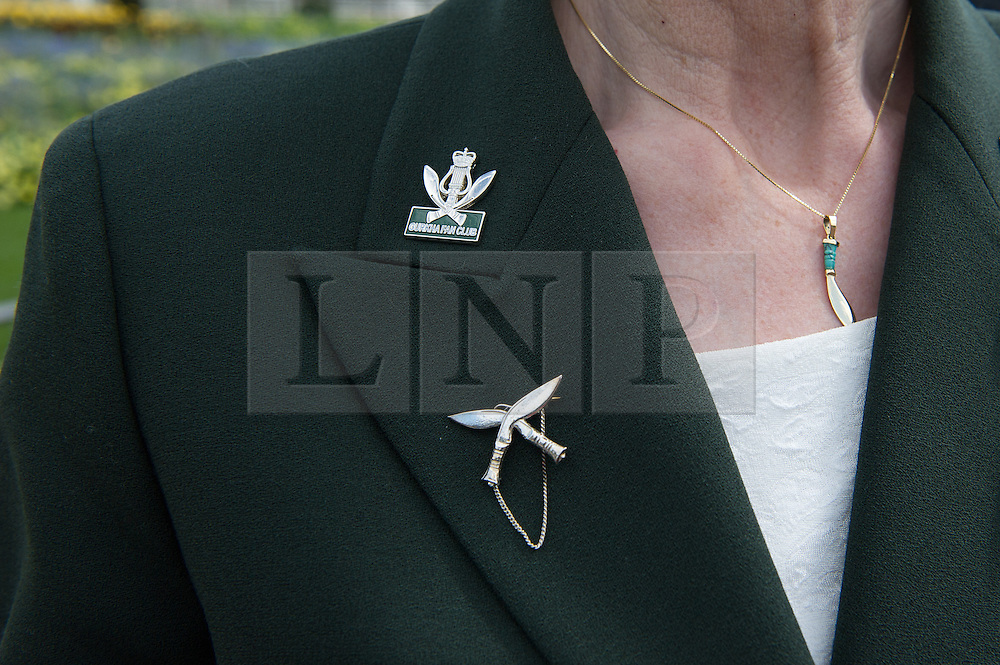 © London News Pictures. 03/04/15. London, UK. A Gurkha supporter wears the traditional symbol of the Gurkhas the 'Kukri', as Gurkha Regiments march down the Mall as part of the 200 year celebrations of the formation of the British Gurkhas, Central London. Photo credit: Laura Lean/LNP