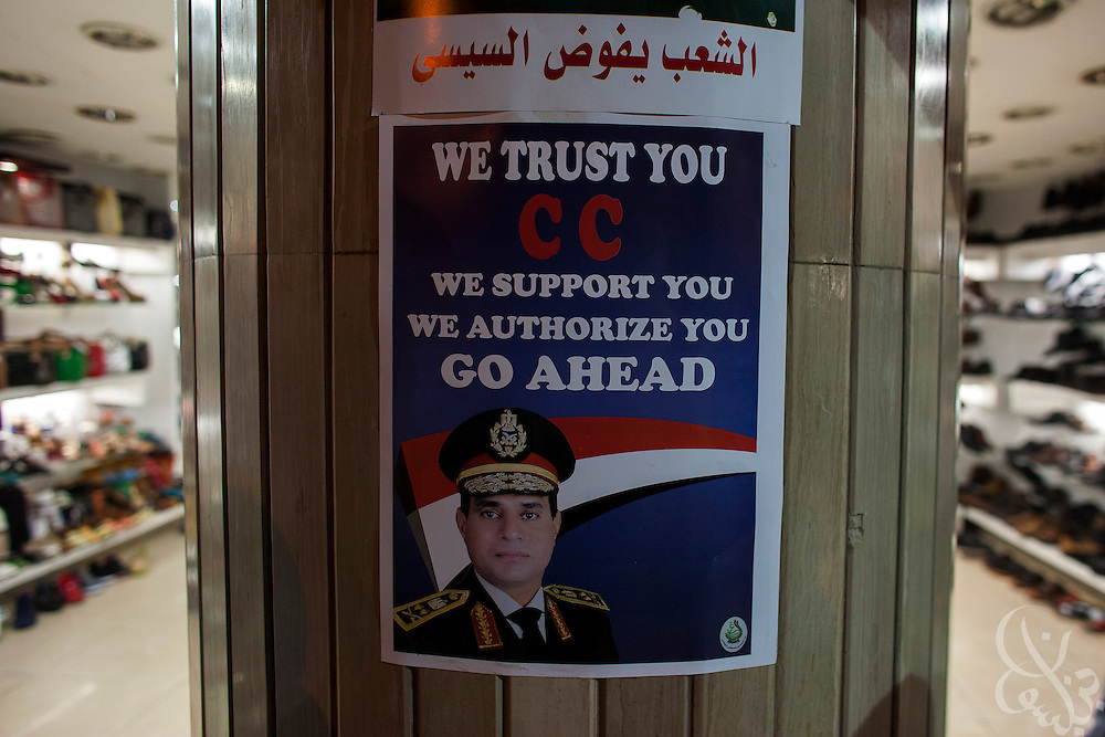 "A sign supporting Egyptian Gen. Abdel Fattah El Sissi, decorates the entrance of a shoe store during a massive street demonstration called for by el Sissi , the head of Egypt's military, in the Tahrir Square area of downtown Cairo Egypt on Friday July 26, 2013. EL Sissi had asked Egyptians to take to the streets on Friday to show the world that he had a mandate to deal with ""violence and terrorism""."