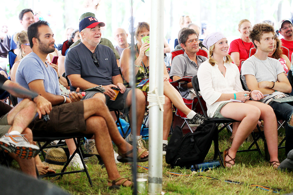 Jim Wallis, second from left, and other festival attendees listen to author Frank Schaeffer speak about worshiping God and not the Bible at the Wild Goose Festival at Shakori Hills in North Carolina June 25, 2011.  (Photo by Courtney Perry)