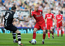 NEWCASTLE-UPON-TYNE, ENGLAND - Sunday, April 1, 2012: Liverpool's Jonjo Shelvey in action against Newcastle United's Danny Guthrie during the Premiership match at St James' Park. (Pic by Vegard Grott/Propaganda)