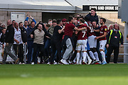 Northampton Towns Andy Williams(9) scores a goal 2-1 and celebrates with teammates and supporters during the EFL Sky Bet League 2 match between Northampton Town and Forest Green Rovers at Sixfields Stadium, Northampton, England on 13 October 2018.