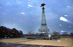 Snow flakes are seen flying by the Eiffel Tower in Paris, Texas as the first signs of winter blew in to the Red River Valley Wednesday, Dec. 8, 2005.