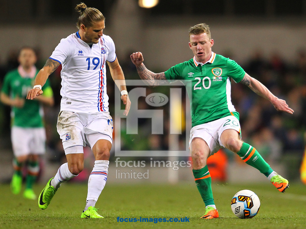Jonathan Hayes of Republic of Ireland and Rurik Gislason of Iceland during the International Friendly match at the Aviva Stadium, Dublin<br /> Picture by Yannis Halas/Focus Images Ltd +353 8725 82019<br /> 28/03/2017