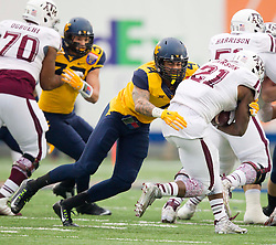 Game action in the first quarter between the West Virginia Mountaineers and the Texas Aggies during the Liberty Bowl in Memphis, TN.