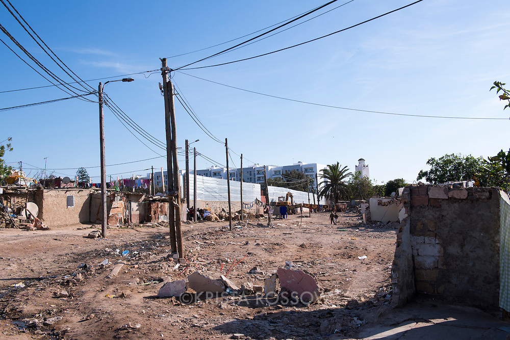 A slum in the outskirts of Casablanca, Morocco, is being encroached upon by condo development.