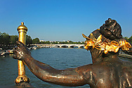 Pont Alexandre III is an arch bridge that spans the Seine, connecting the Champs-Élysées quarter and the Invalides and Eiffel Tower quarter, widely regarded as the most ornate, extravagant bridge in Paris.  The construction of the bridge is a marvel of 19th century engineering, consisting of a six metre high single span steel arch.